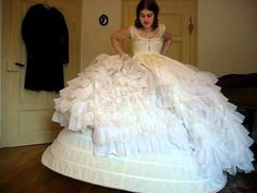 Putting on a crinolinedress - YouTube and petticoat very useful for future ball gowns