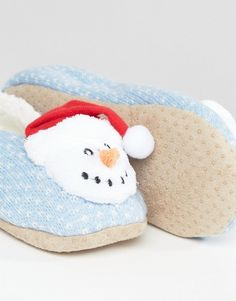 An adorable pair of festive slippers like these from ASOS make a cute secret santa gift! Especially if you have a cold office!