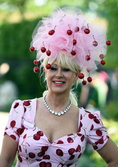 Pink dress and hat with deep red cherries The most bonkers hats from Ascot 2015