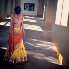 Yellow lehanga with gold work, orange dupatta with antique gold and got pink blouse with deep neck. [Half saree, langa oni] Chamee and Palak