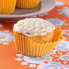 Golden Orange Cupcakes Recipe -Citrus lovers will vow they've gone to cupcake heaven when they sample this recipe. To up the sunny flavor, add a teaspoon of orange extract in place of vanilla. —Helen Hassler, Denver, Pennsylvania