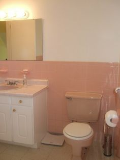 If you are buying an older home, don' let this stop you! pink bathroom before-- painted tile project