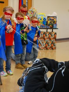 Cute ideas for a superhero party-the kids get the defeat a villain who plans to steal the birthday cake