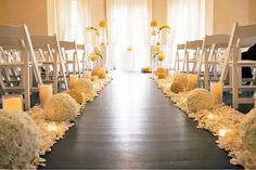 No yellow,thick row of white rose petals down the aisle with touches of green cymbidium orchids to be placed throughout.