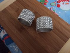 DIY napkin rings: used with toilet paper rolls, rhinestone mesh, and silver paint!