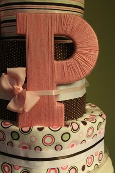 my creation wooden letter p wrapped in pink yarn it sat on a diaper cake i made for my sister in laws baby shower