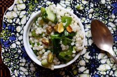 green Israeli couscous salad. obsessed with Israeli/pearl couscous. I'm making for a potluck, using chevre instead of feta.
