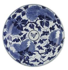 APANESE ARITA EXPORT BLUE AND WHITE DISH  EDO PERIOD, LATE 17TH CENTURY  decorated with citron and peony enclosing a central monogram of the Dutch East India Company, 'VOC'