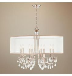I can modify this to cover the chandelier in our rental... thin wire hoops, wider strip of fabric (that is more opaque)