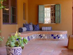 Decorating house veranda with Mexican tiles will add Southern ingredient to the house decor overall. In this case interior designer installed made of concrete bench with blue and whiten mexican til…