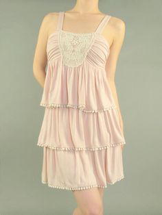 Pretty layered ruffle dress with embroidery perfect for spring!