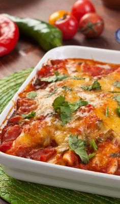 Weight Watchers Friendly Chicken Taco Casserole Recipe with Tomato Sauce, Tortilla, Tobasco Sauce, Low Fat Cheddar Cheese, Refried Beans, Sour Cream, Salsa, Lettuce, Onion, and Green Pepper - 15 Minute Prep Time - 7 Smart Points