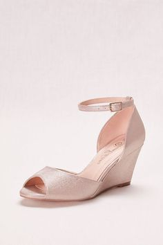 1a04172519b Be sure to leave an impression wherever you step in this shimmering peep  toe wedge! DeBlossom Collection Heel Ankle Strap Crafted in China