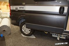 """Karyn Torcoletti, Director Of Marketing for the Erwin Hymer Group North America gave Crazy Al Cayne a tour of the awesome Hymer """"Aktiv"""" camper van/motor ho"""