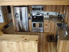 My log cabin kitchen cabinetry and stainless steel appliances. Kitchen Cart, Kitchen Decor, Kitchen Ideas, Log Cabin Kitchens, Getaway Cabins, Stainless Steel Appliances, Kitchen Cabinetry, Home Repair, Beautiful Kitchens