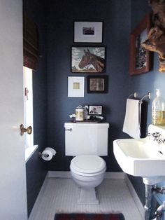 "Traditionally, we've always been told NOT to paint small rooms a dark color. ""Dark paint closes the room in and makes it smaller than it already is!"" Blah, blah, blah. Well, here are ten bathrooms that are getting it right when it comes to dark and dramatic. A lovely dark bath with a gallery wall to add height via Liz Daly Photography Dark walls and all white accessories keep things balanced via Emma Reddington of The Marion House Book Keeping one wall a light color helps reflect so..."