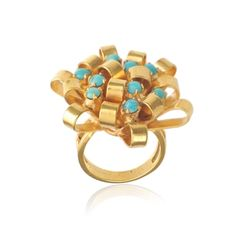 Turquoise Bow Ring by Freddie & Cinnamon. Our bow ring looks like an unfurling of gold ribbons with turquoise balls nestled within its 21 carat gold micron plating on sterling silver surface.   £128