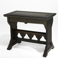 Beautiful Cincinnati art-carved table by Benn Pitman and Anna Jordan, ca. 1880. The table combines design elements from Gothic architecture with naturalistic plant-based decoration, creating strong negative shapes that balance the delicate shallow relief carving.