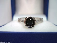 14K White Gold Black & White Diamond Engagement Ring 0.62ct. $820.00, via Etsy.