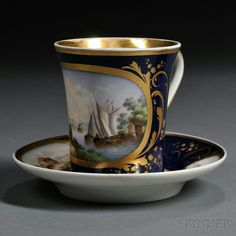 Popov Porcelain Landscape-decorated Cup and Saucer, Russia, c. 1830, gilded trim to a dark blue ground, the cup with polychrome decorated cartouche of a harbor scene, the saucer with buildings in landscapes, factory mark, saucer dia. 6 in.