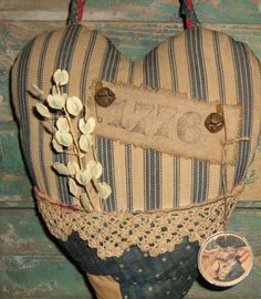 """""""1776"""" Primitive Heart Door Pocket by PrairiePrimitives. Made from antique feather ticking, antique quilt, antique handmade lace, reclaimed rag rug, and more! Available on Etsy for just $32.00."""