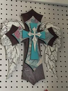 This is a very unique and beautiful layered cross. The cross is made from MDF and Birch Wood, that is hand painted. There area total of 5 layers that make up th