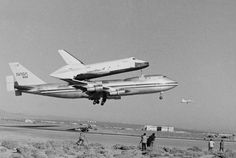 FILE - In this Feb. 18, 1977 file photo, America's Space Shuttle Enterprise, rides atop a giant 747 on its first test flight at Edwards Air Force Base, Calif. Enterprise has been separated from the NASA 747 Shuttle Carrier at John F. Kennedy International Airport, just weeks after flying over New York City. Next month it will be taken by barge to the aircraft carrier USS Intrepid, the floating air-and-space museum that will be the shuttle's ...