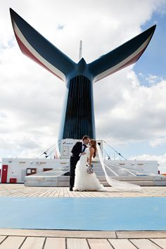 Our Wedding Day! It was so perfect! I wanted a photo with the whale tail! Frame worthy! Carnival Cruise Wedding 10.11.14 on Liberty