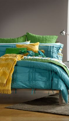 FAV: these colors! love these different, bold colors; blue green and yellow as the base colors. all solid. pillows can add slight touches of other colors