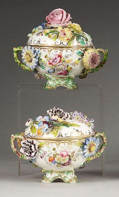 A pair of English porcelain floral encrusted vases and covers, circa 1830,