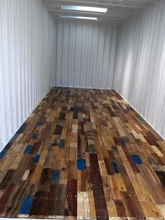 Wood pallet floor shipping container. Great for reuse of materials... One step further than just reusing the container.