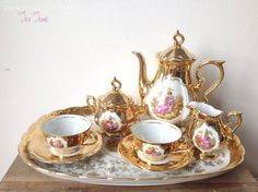 The following item on display features an 8 piece antique tea set (marked Schaller Wiesau Bavaria Germany), decorated with lots of gold and
