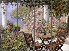 Scenic painting of Positano on ceramic tiles for kitchen backsplash mural idea.