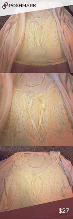 """Banana Republic Elegant Ivory Lace Camisole Top L Gently Worn once or twice; Light Fraying on some Lace due to type of delicate material; Exquisite & Elegant Ivory Lace Camisole Top; Delicate Satin Bow on Front; Light, Sheer Lining Behind Lace (See last picture); Lace on Front/Back and Shoulders; Light Ribbed Cotton on Lower Half of Top; Size L; Romantic and Ladylike Top; Please See Picture of my """"THINK PINK!"""" Listing to see an example of an outfit where this Top makes a Chic feminine…"""