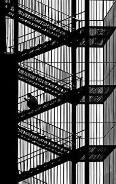 """mpdrolet:  Bahadir Bermek  "" lines, urban, reading, stairwell, staircase, fire escape, sillouette, flights, ascending, descending, photography, architecture, public spaces:"