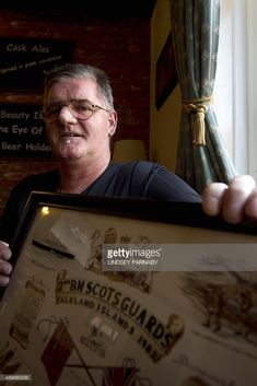 Falklands War veteran Gordon Hoggan poses for pictures in his local pub during an interview with AFP in Derby, East Midlands, England, on November 5, 2014. The 55 year old ex-Scottish Guardsman is haunted by the memory of an Argentine soldier he bayonetted to death during a key battle in the Falklands War and said he wants to meet the man's family.