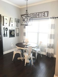 Dining Room Gallery Wall in a farmhouse style dining room with barn door. DIY's and ideas., letter decor, lighting, eat, letter decor, rustic, eat, dining room, table, furniture, hardwood floor, window, rustic, kitchen, light, rustic, farmhouse, kitchen d