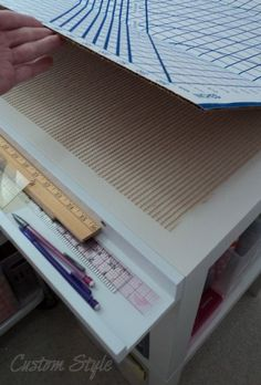 IKEA RIBBA picture ledge - for pens, pencils and ruler storage. Attach to side of cutting table.