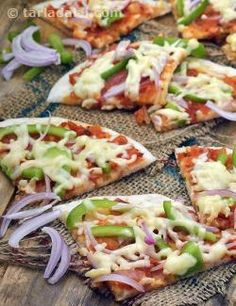 What a fun way to make use of leftover uttapas! The Uttapam Pizza is so tasty that your kids will want you to make this every time you make dosa batter. From onions and capsicum, to pizza sauce and cheese, the Uttapam Pizza has all the basic ingredients that go into your favourite pizza. Put on your creative caps and make the Uttapam Pizza just the way you want to. Throw in your choice of toppings from pineapples and sweet corn to olives, top it with your own combo of sauces and perhap...