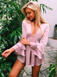 Obsessed with this pink ruffled romper.