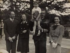 The Duke and Duchess of Gloucester with Lord and Lady Mountbatten, who hold a young Prince William of Gloucester