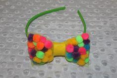 Multiple colored Pom Pom tulle headband.