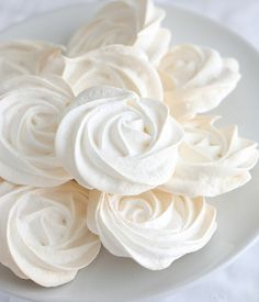 easy, simple vanilla meringues. paint on a little red food coloring and they'd be great red roses for an alice in wonderland party