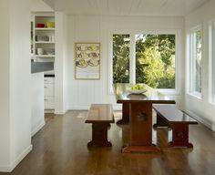wood panels painted white, dark wood floor, light ceilings, lots of windows :)