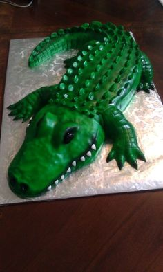 The alligator cake was made using an sheet cake, cut in half then stacked to make the belly. We only needed 25 servings so the head, tail, arms & legs were made using RKT.all covered in fondant then airbrushed. Alligator Birthday Parties, Alligator Party, 5th Birthday, Birthday Cakes, Birthday Ideas, Alligator Cupcakes, Animal Birthday, Crocodile Cake, Crocodile Party