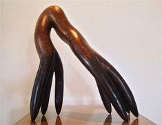 Sculpture in bronze, title Daughter of Comb  | Experience Jamaique