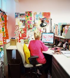 Work Chair Photo - A Lilly Pulitzer employee at work in front of a colorful inspiration board