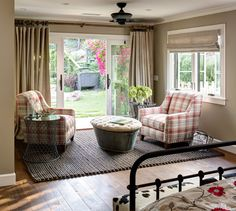 Galvanized bucket with tufted top as footstool.  Farmhouse Bedroom by Anne Sneed Architectural Interiors