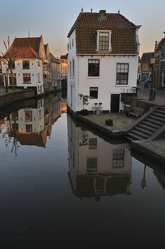 Reflection of canal houses by dusk | Oudewater, the Netherlands