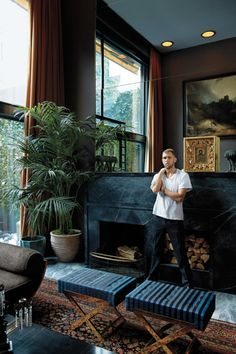 This mirrored wall brings in so much light reflection that the moody dark colors are cozy not drab…. James Oakley in the living room of his townhouse in the West Village. Design by Fernando Santangelo. Decoration Inspiration, Interior Inspiration, Decor Ideas, Interior Architecture, Interior And Exterior, Living Room Decor, Living Spaces, Living Rooms, Decor Scandinavian